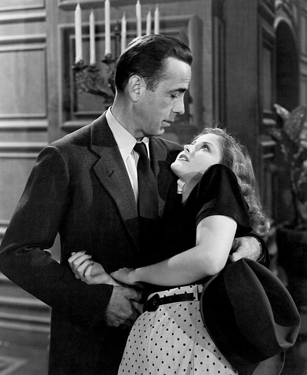 Humphrey Bogart as Philip Marlowe and Martha Vickers as Carmen Sternwood